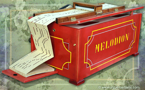 Photo du Melodion version rouge, de Orgue-barbarie.com